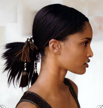 African American hairstyle pulled back in a pony tail