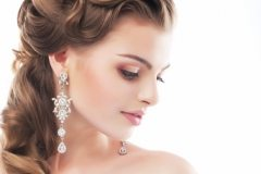 Beautiful wedding hairstyle puled back behind the ears