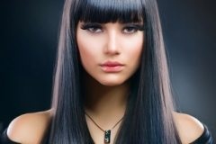Beautiful Brunette woman with Long Staright Hair and Bangs