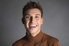Laughing young man with attractive smile