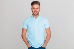 portrait of relaxed young man wearing light blue polo t-shirt