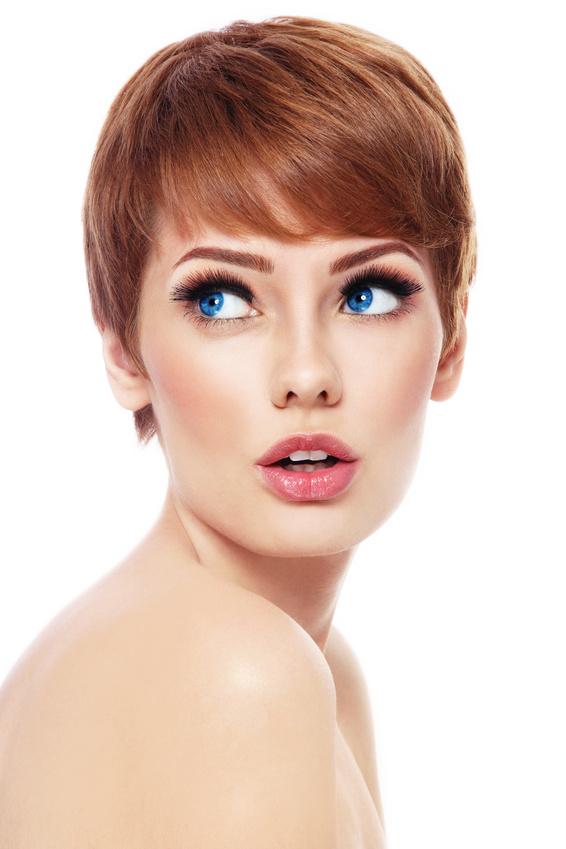 Young beautiful woman with stylish short haircut and fresh make-up looking upwards