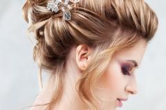 Wedding style. Beautiful young bride with luxury wedding hairstyle